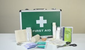 First aid kit on table with contants