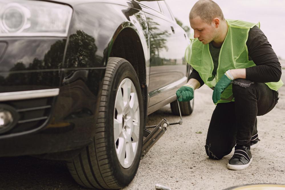 man-changing-broken-wheel-car