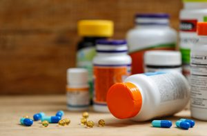 medicine-bottles-tablets-wooden-desk