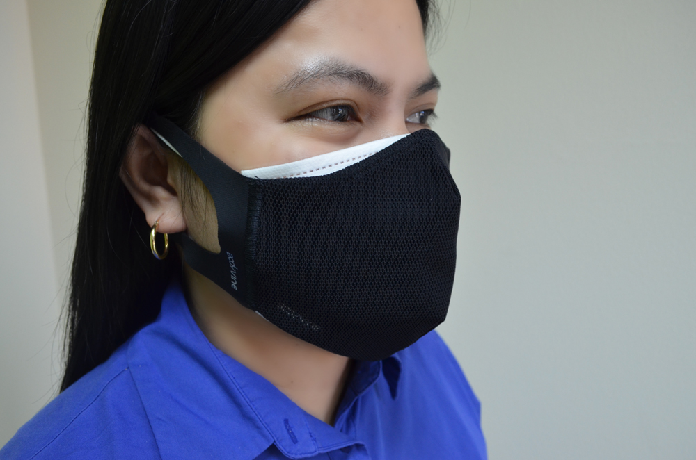 Woman wearing surgical mask and cloth mask